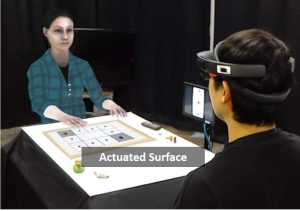 Mixed Reality Tabletop Gameplay: Social Interaction with a Virtual Human Capable of Physical Influence